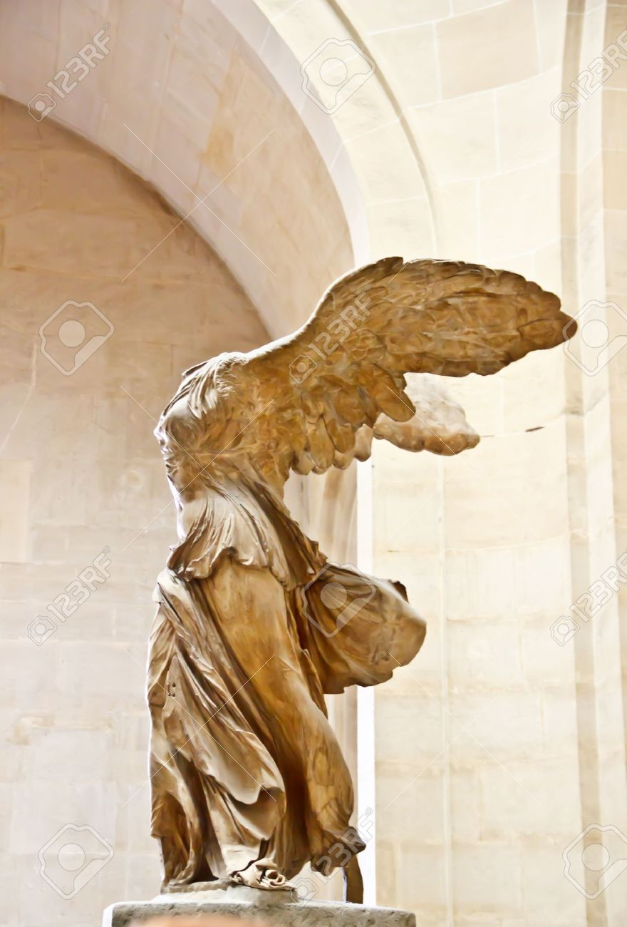 Stock Photo - The famous sculpture wings of victory ar Nike at Louvre  museum, Paris