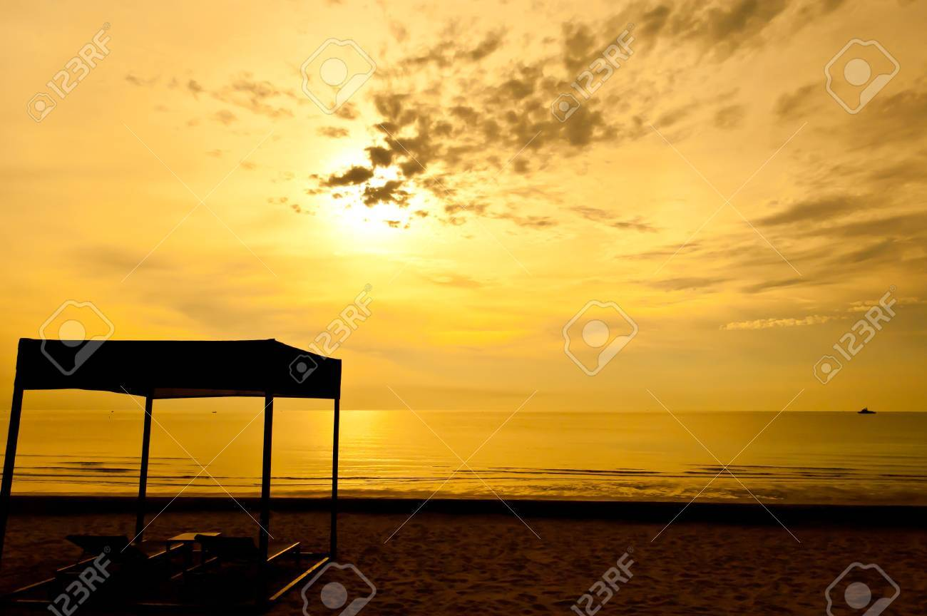 Beach beds and tent at colorful dawn Stock Photo - 11232119
