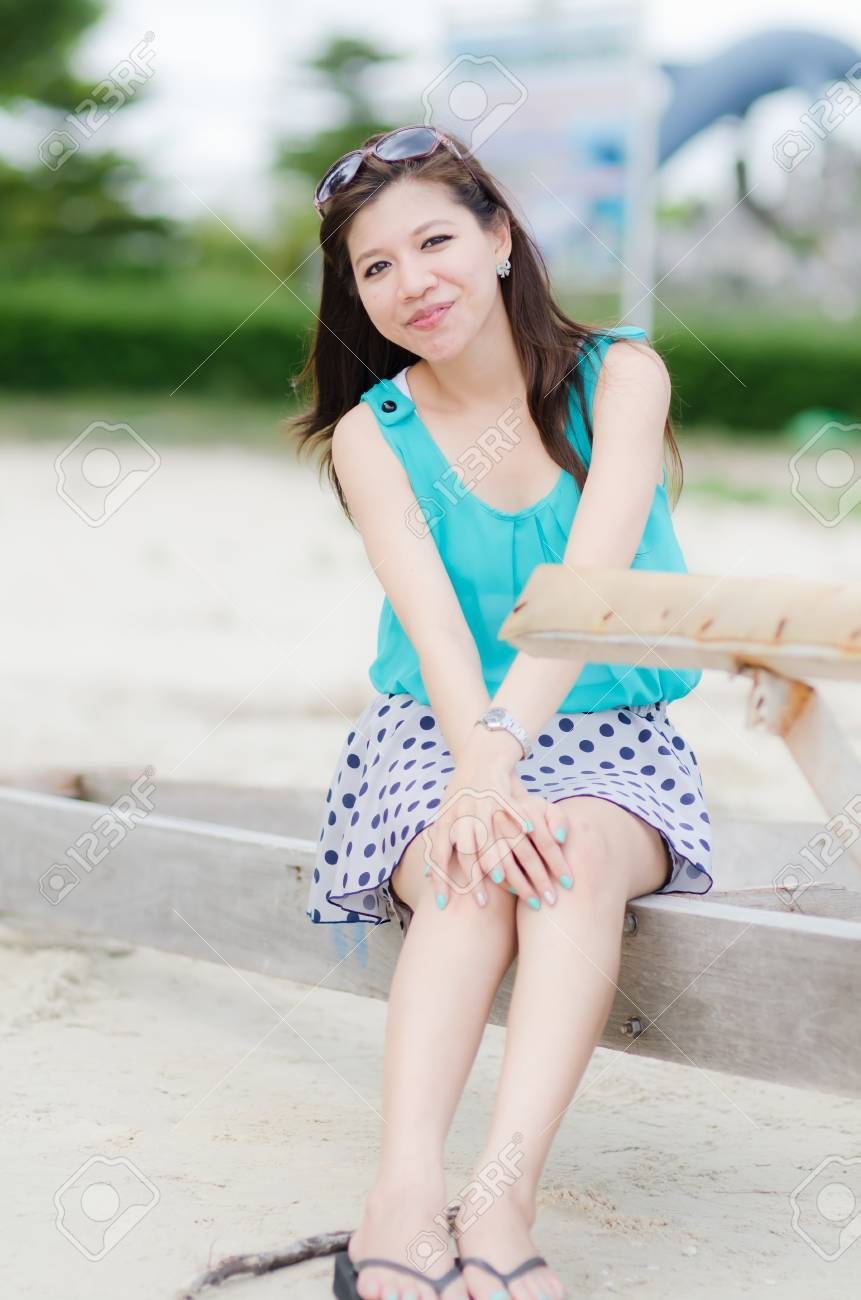 Happy Asian Woman on the beach Stock Photo - 12983750
