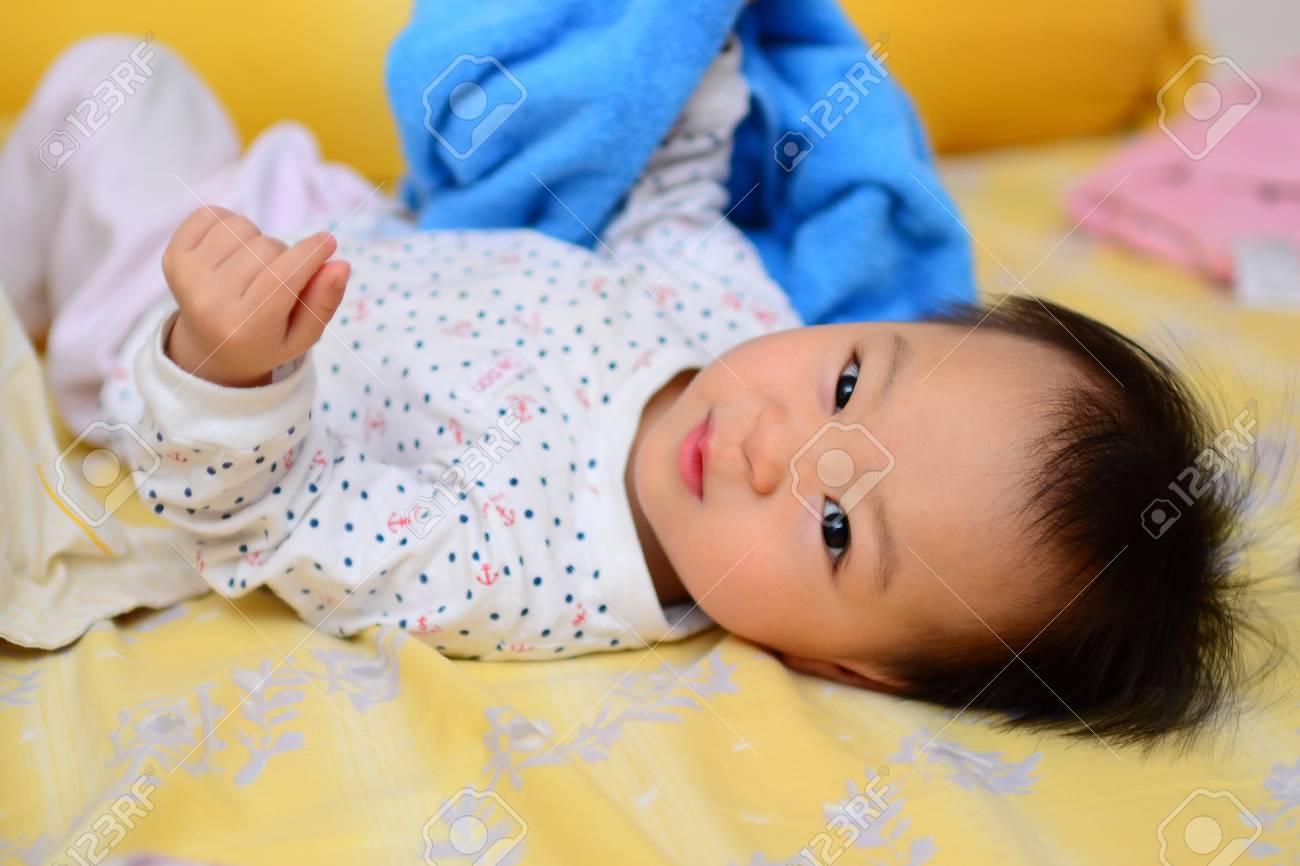 A shot of a cute asian baby girl - 13258601