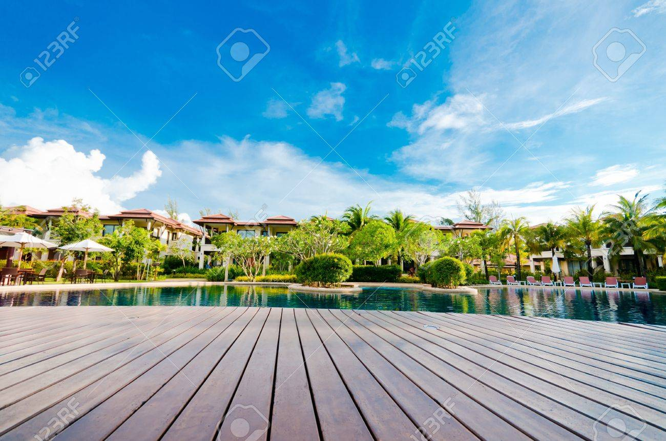 Landscape with pool village and blue sky and cloud - 13537981