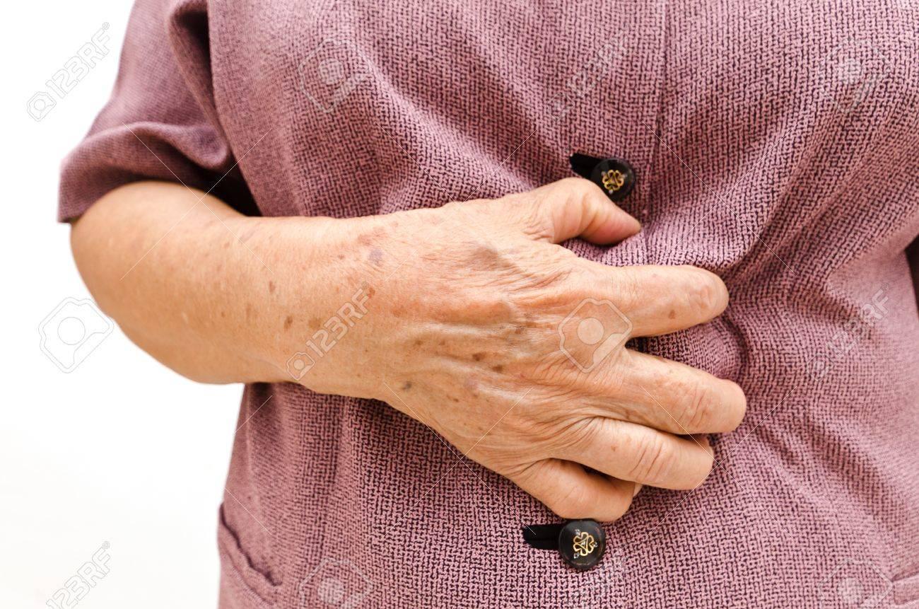 Senior woman having a stomachache - 14906903