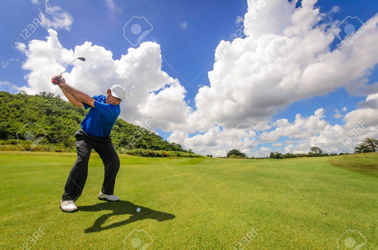 Golfer swinging his gear and hit the golf ball from tee to the fairway, slow shutter motion blur Stock Photo - 15723647