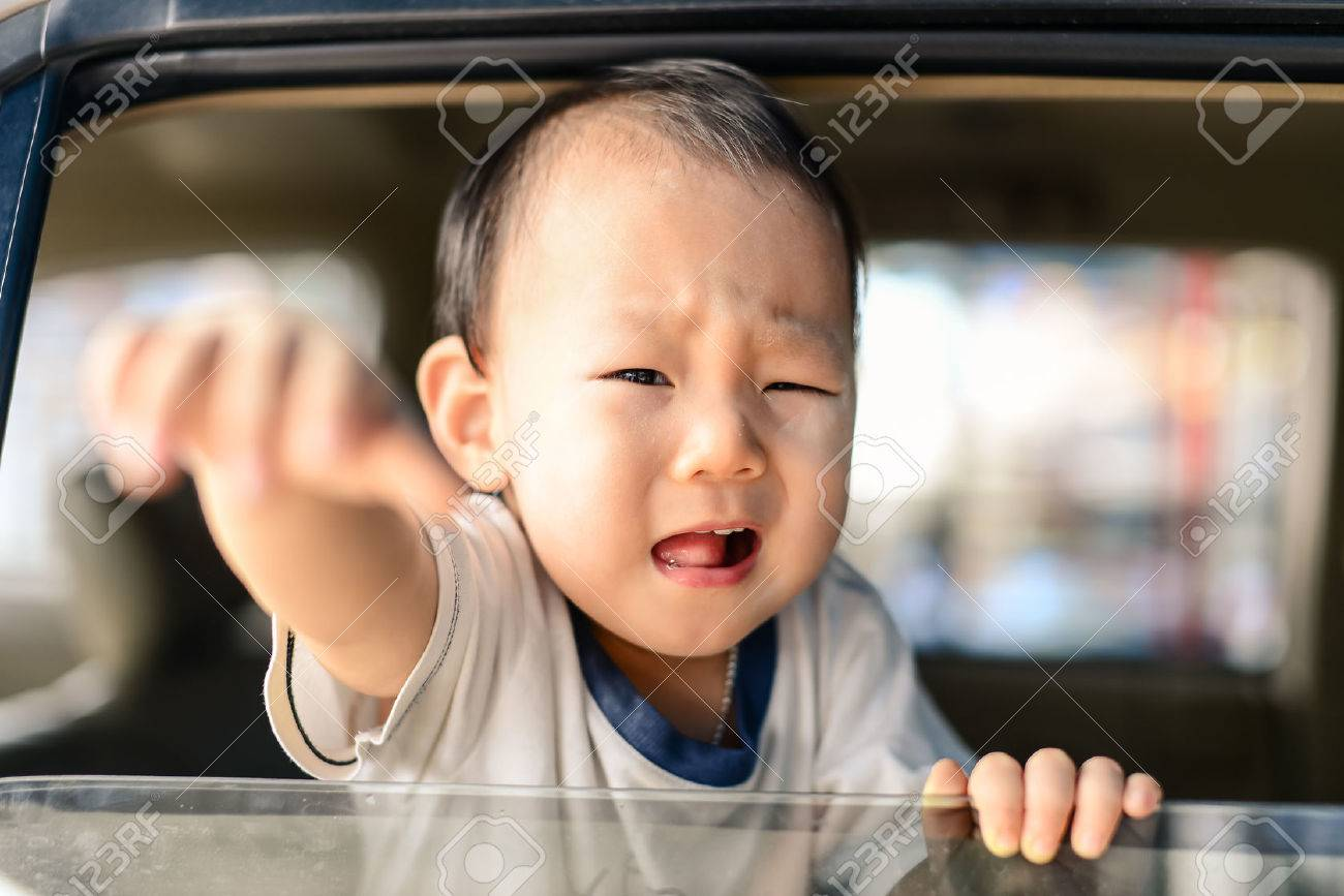 Crying Asian baby in car, safety concept. - 33336636