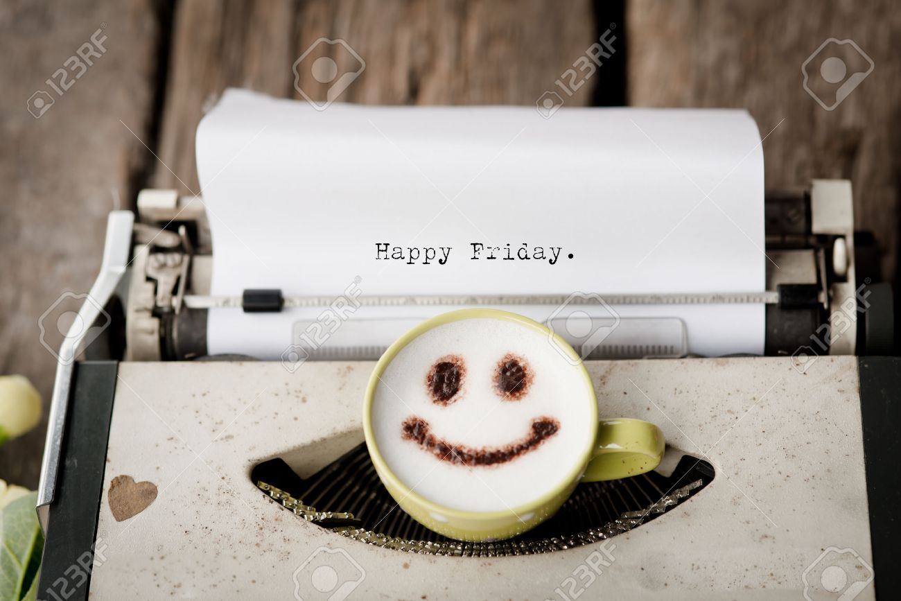Happy Friday on typewriter with happy face coffee cup, sepia tone. - 36520393