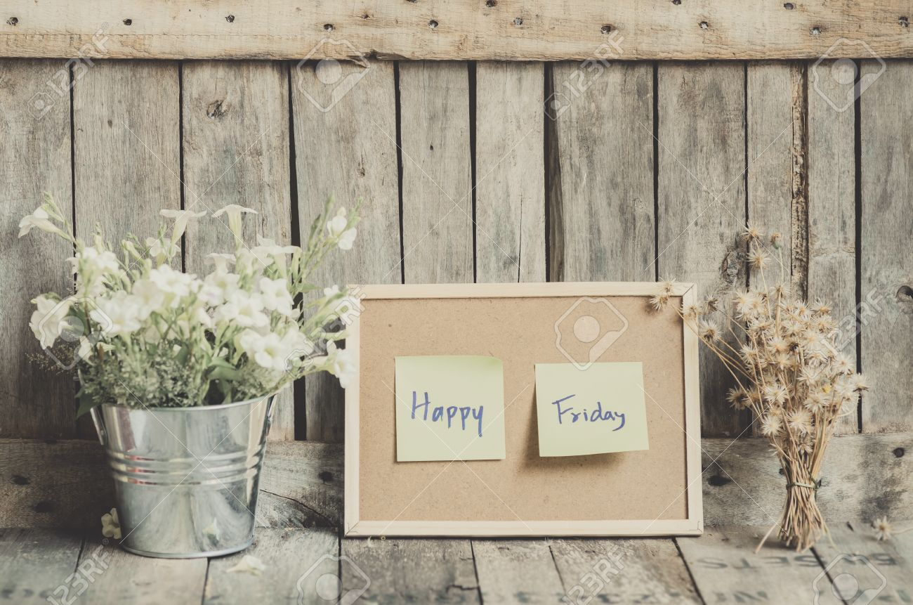 Vintage Style Effect Happy Friday Message On Corkboard With Flowers