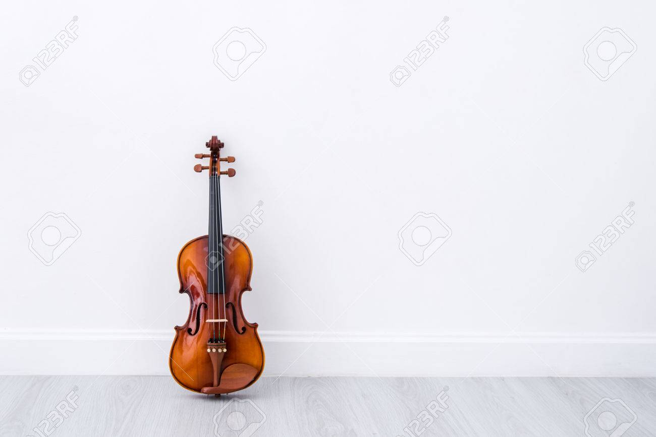 Classical cello on white wall background - 47438600