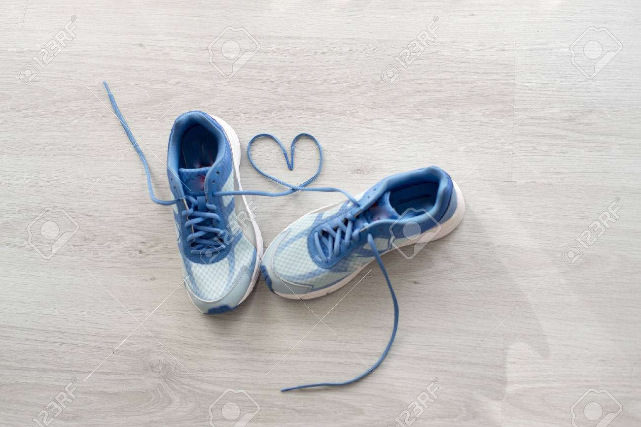Love sign, Selective focus close up blue sport shoes on gray floor. - 50444770