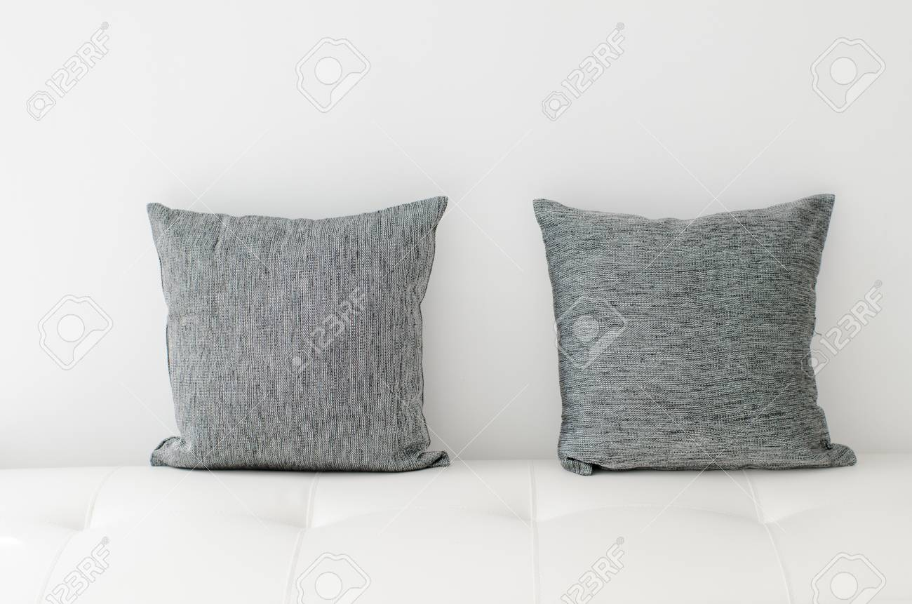 Black Decorative Pillows On A White Casual Sofa In The Living