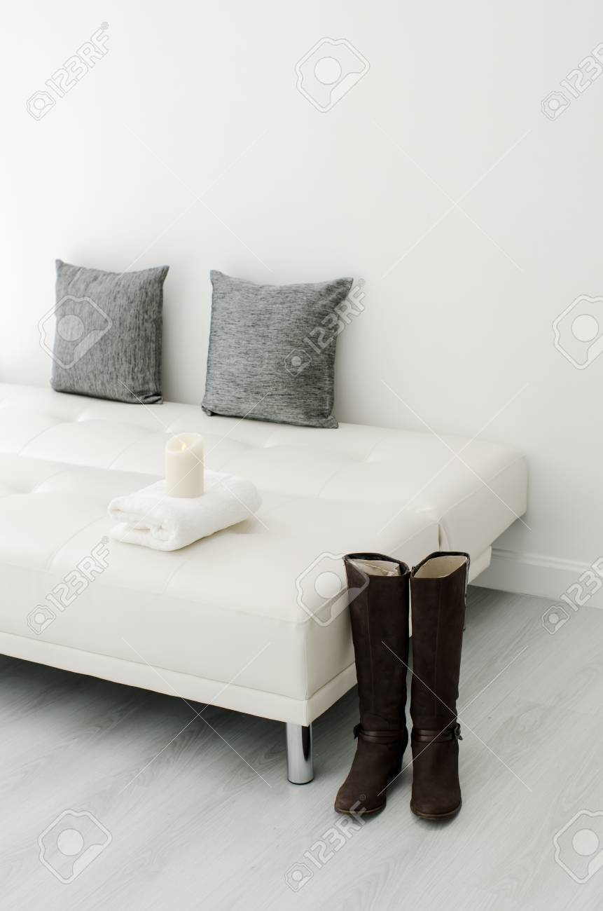 Black Decorative Pillows On A White Casual Sofa In The Living ...