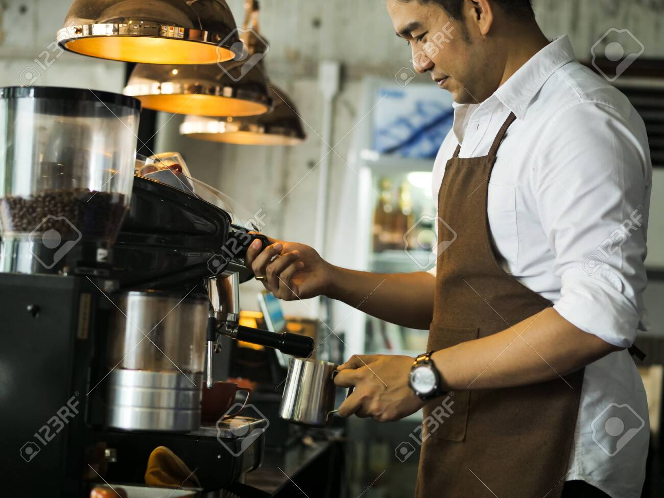 Happy Asian barista man working in cafe, lifestyle concept. - 128547279