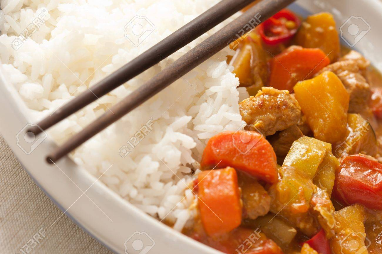 Delicious pork curry served with hot Thai jasmine rice Stock Photo - 12851467