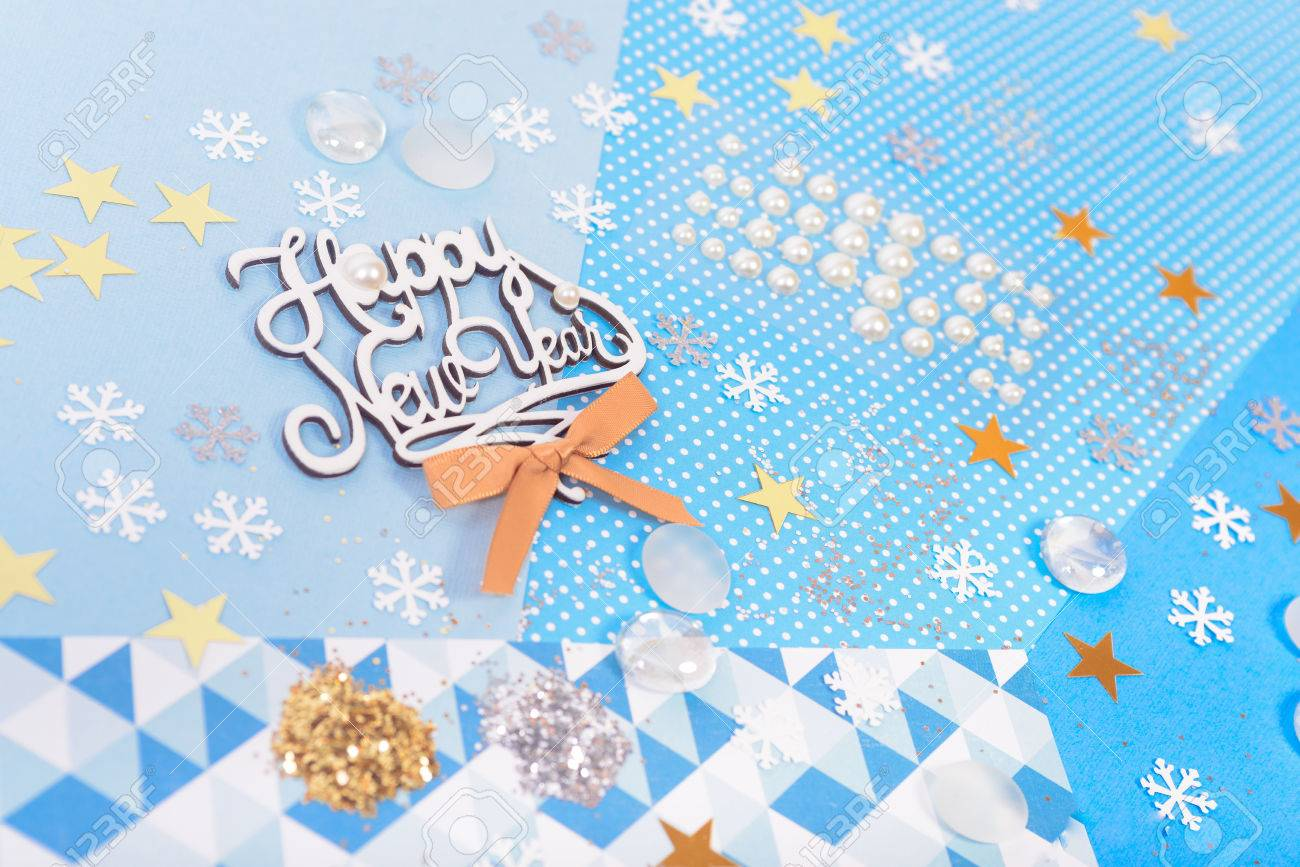 bright and shiny accessories on colorful paper for christmas and new year card making and scrapbooking