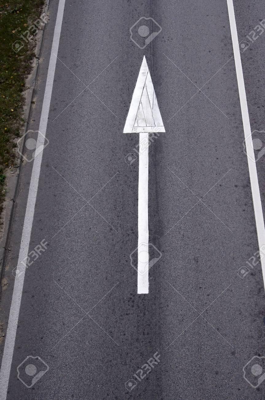White arrow on Surface traffic Stock Photo - 12251027