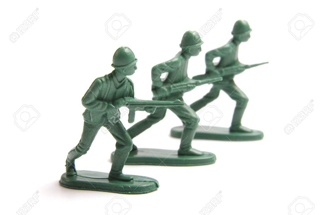 Three toy soldiers on a white background Stock Photo - 12374348