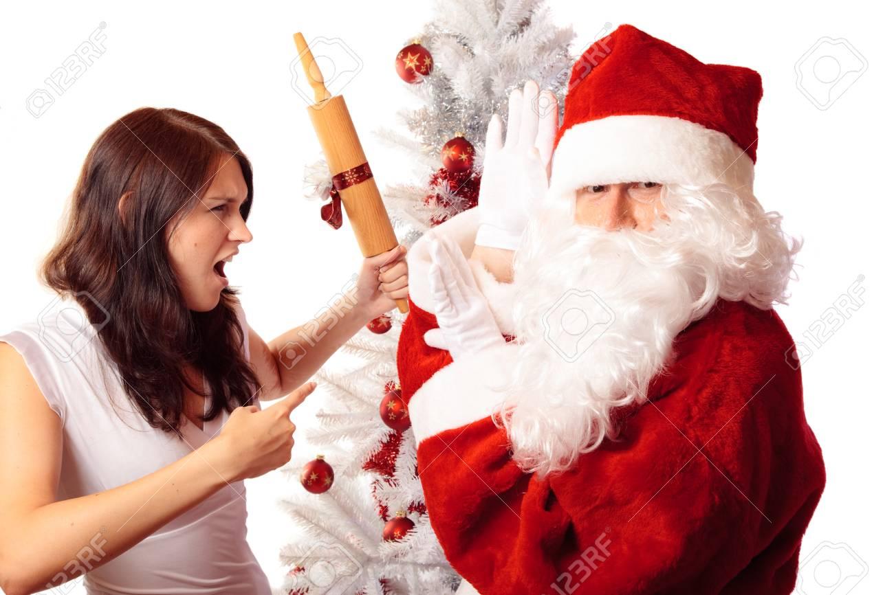 Frapper Le Père Noël Avec Le Cadeau Stupide Qu'il A Apporté Banque