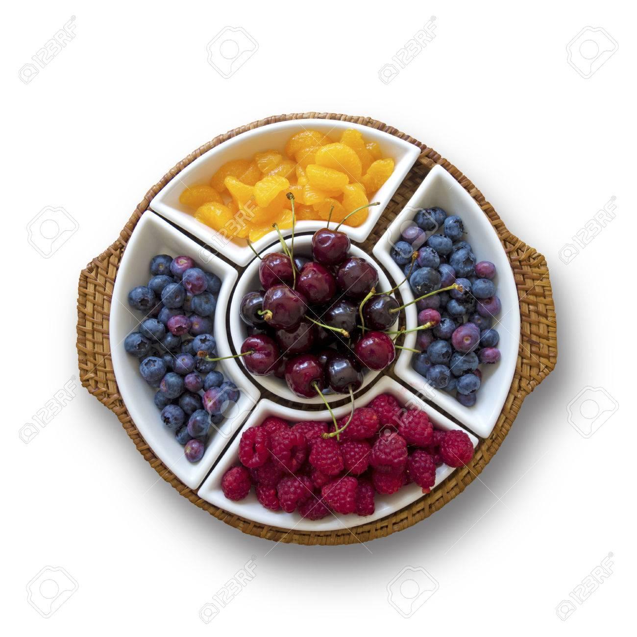 Decorative fruit bowl on white background stock photo 43781352