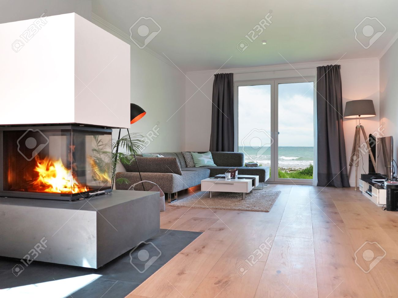 Modern Living Room With Fireplace Modern Living Room With Fireplace And A View To The Sea Stock