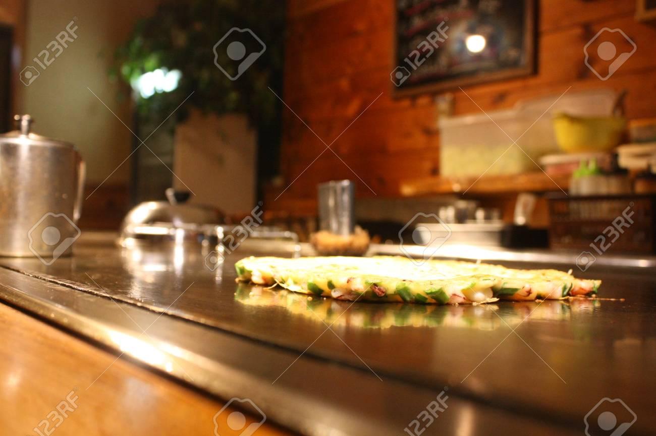Okonomiyaki Japanese Savory Pancake At A Traditional Japanese Stock Photo Picture And Royalty Free Image Image 101071180