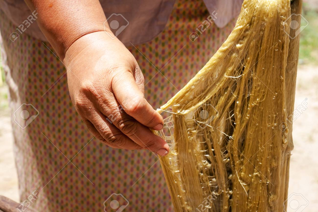 Process of weaving, dyeing, weaving ancient Thailand as silk Stock Photo - 23831059