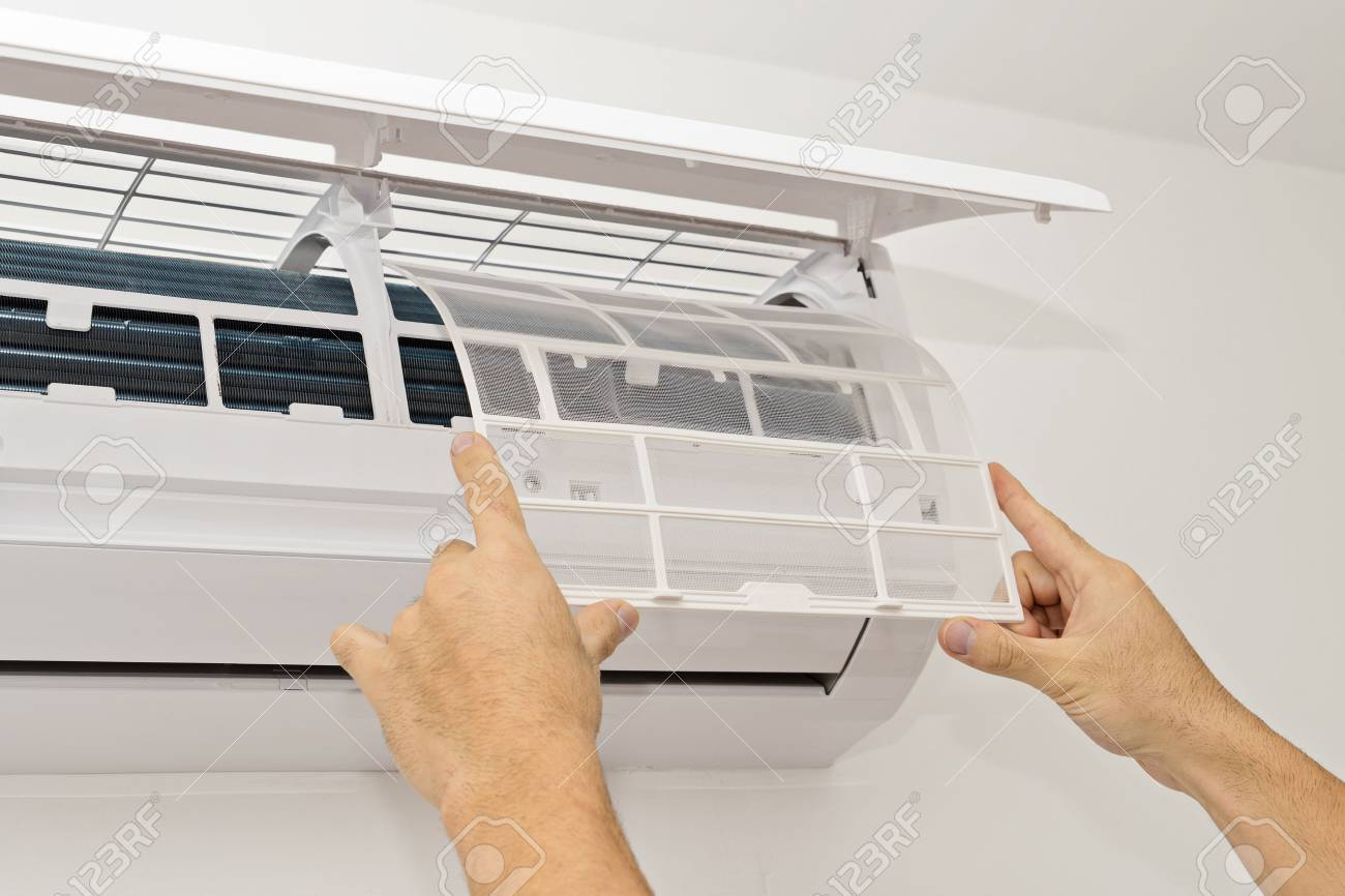 Changing the Filter in the Air Conditioning The Concept of Safe and Healthy Housing - 87696688