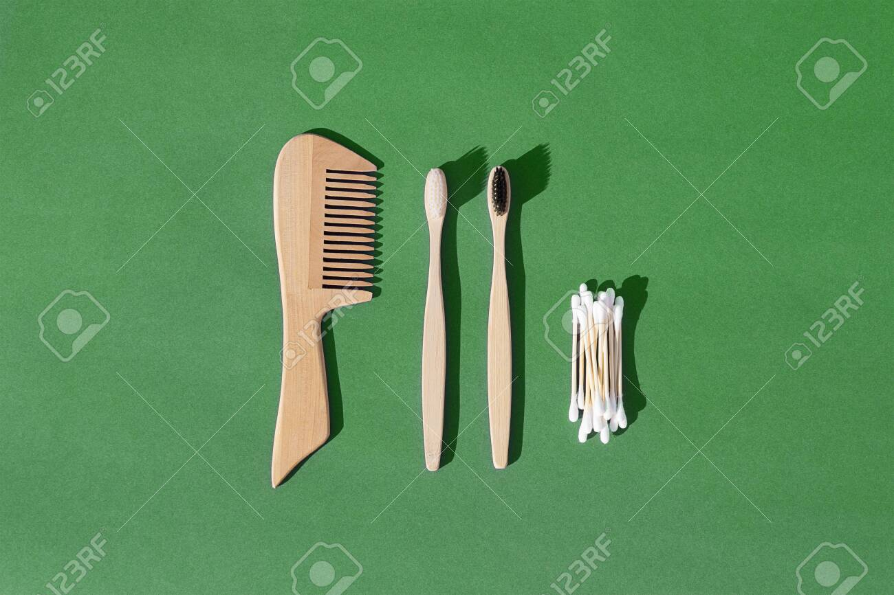 Set of wooden hairbrush, toothbrush and cotton buds made from