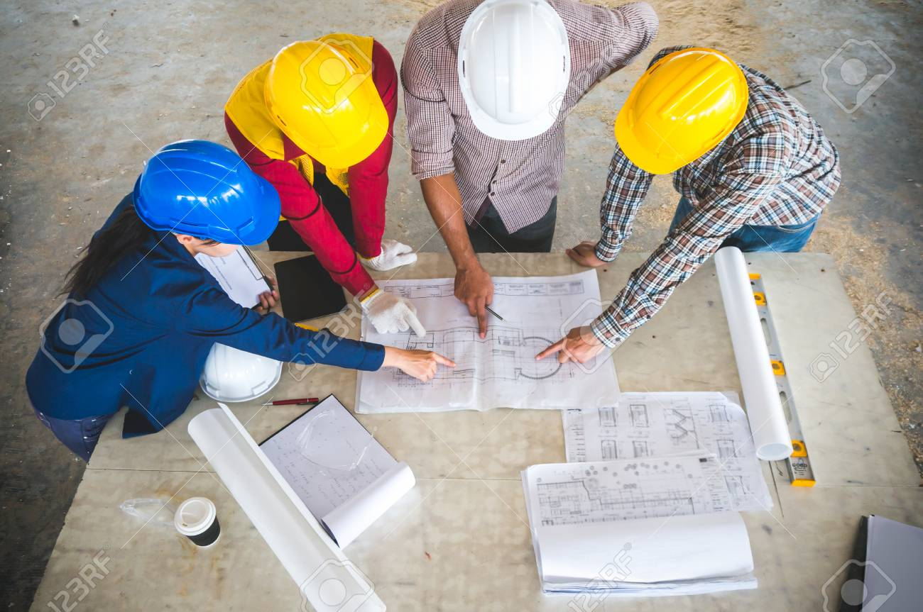 Engineer and foreman meeting at site with blueprint - 120133800