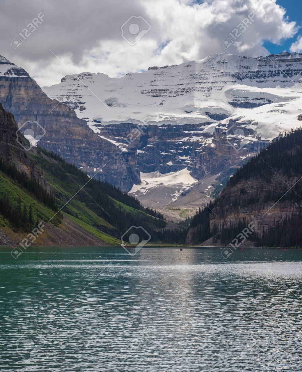 Lake Louise with mountain cover by snow on the background in sunny summer day, Alberta., Canada - 115023899