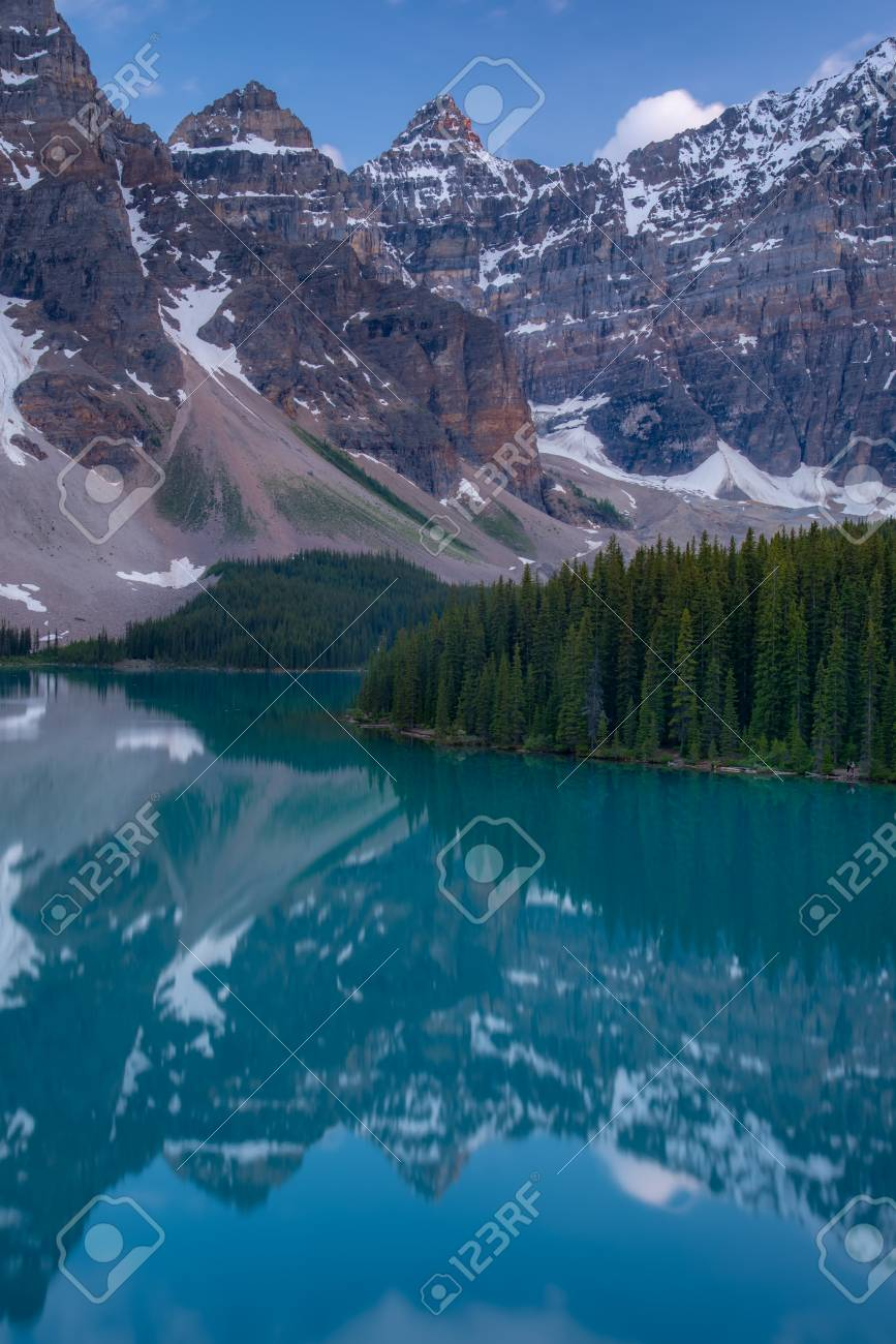Vertical of The Moraine lake sunset with turquoise lake and bluesky, Banff, Alberta, Canada - 115023903