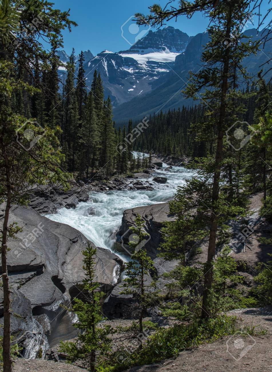 Mistaya canyon in summer beautiful blue sky in sunny day with mountain and river flowing , Alberta, Canada - 115023909
