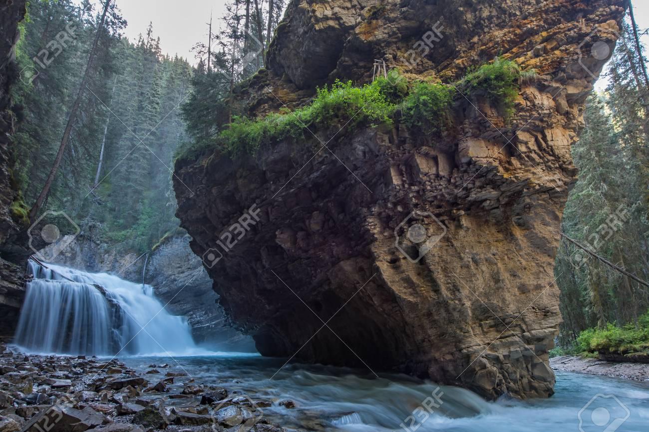 Johnston Canyon cave in Spring season with waterfalls, Johnston Canyon Trail, Alberta, Canada. - 115343568
