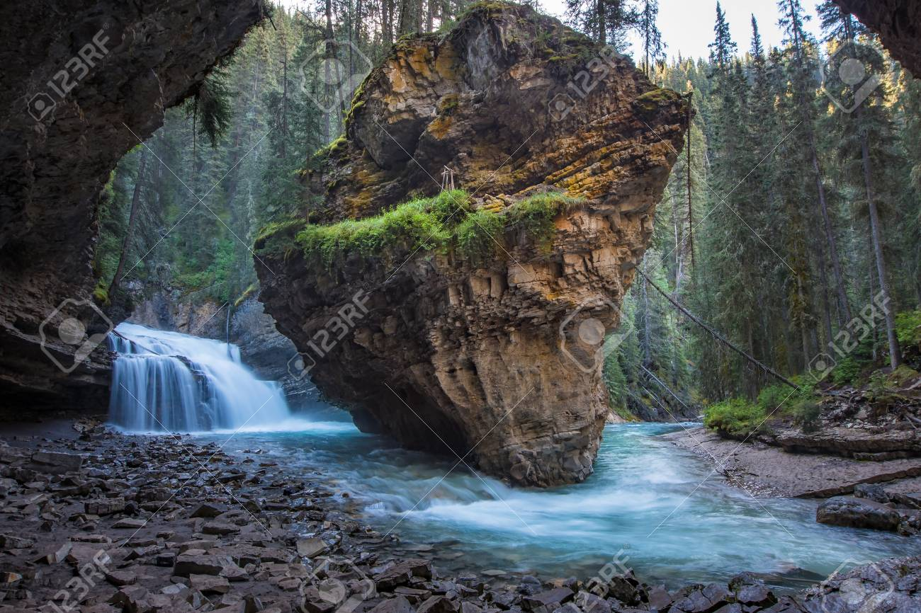 Johnston Canyon cave in Spring season with waterfalls, Johnston Canyon Trail, Alberta, Canada. - 115343606