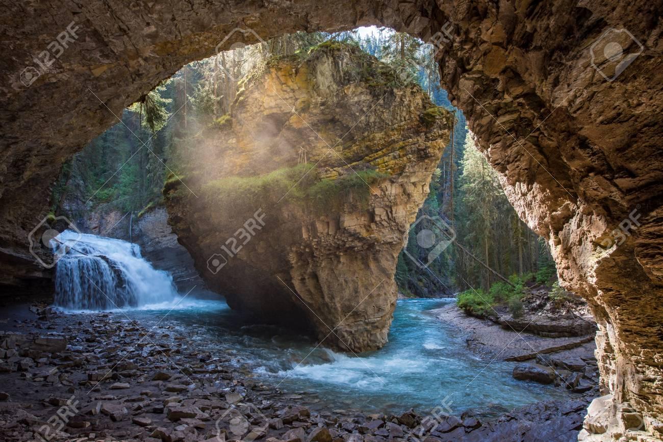 Johnston Canyon cave in Spring season with waterfalls, Johnston Canyon Trail, Alberta, Canada. - 115343518