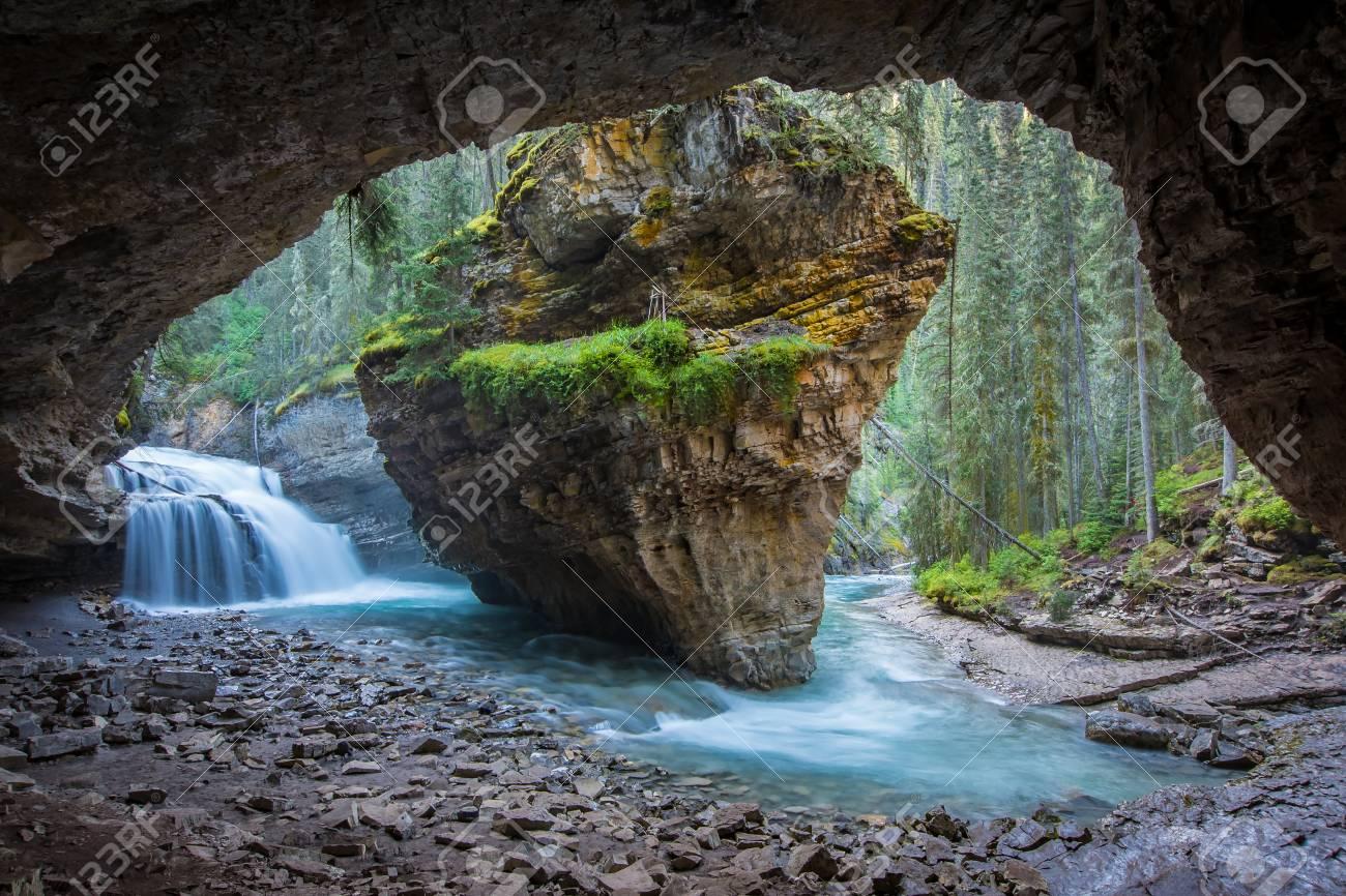 Johnston Canyon cave in Spring season with waterfalls, Johnston Canyon Trail, Alberta, Canada. - 115503223