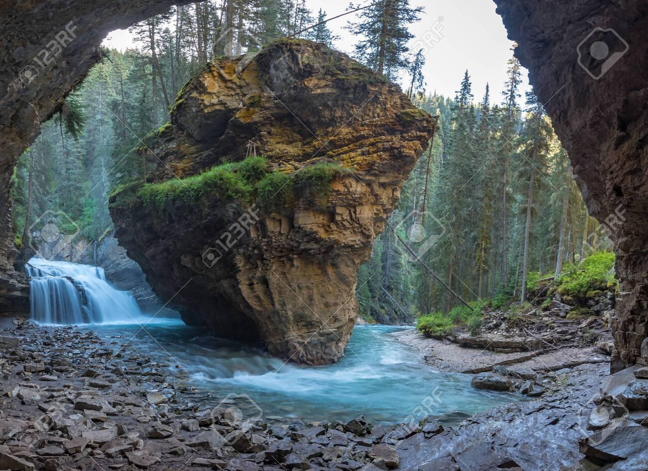 Johnston Canyon cave in Spring season with waterfalls, Johnston Canyon Trail, Alberta, Canada. - 115503224