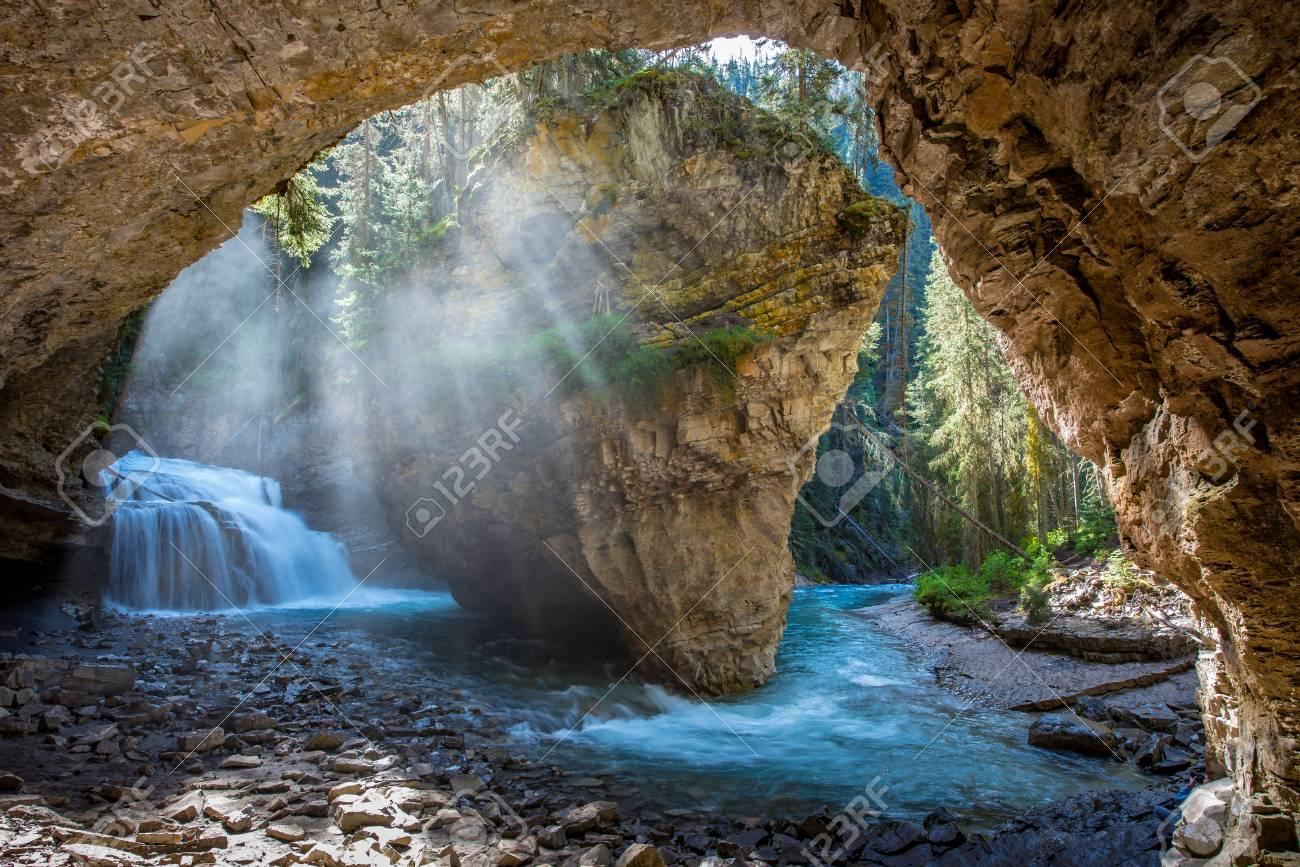 Johnston Canyon cave in Spring season with waterfalls, Johnston Canyon Trail, Alberta, Canada. - 115503228