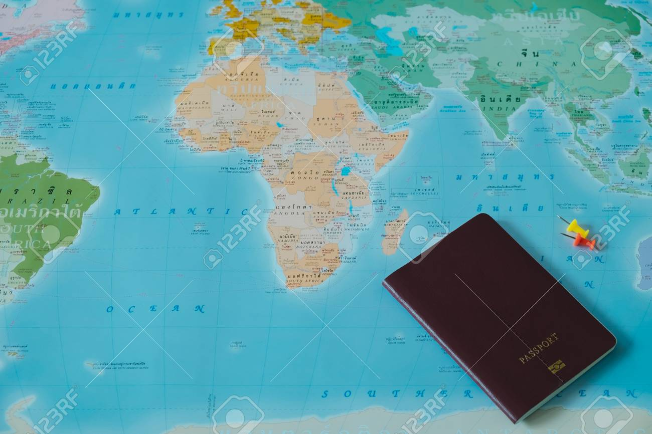 Top view color world map with small pin and passport book placed stock photo top view color world map with small pin and passport book placed on them this image for international travel equipment country concept gumiabroncs Choice Image
