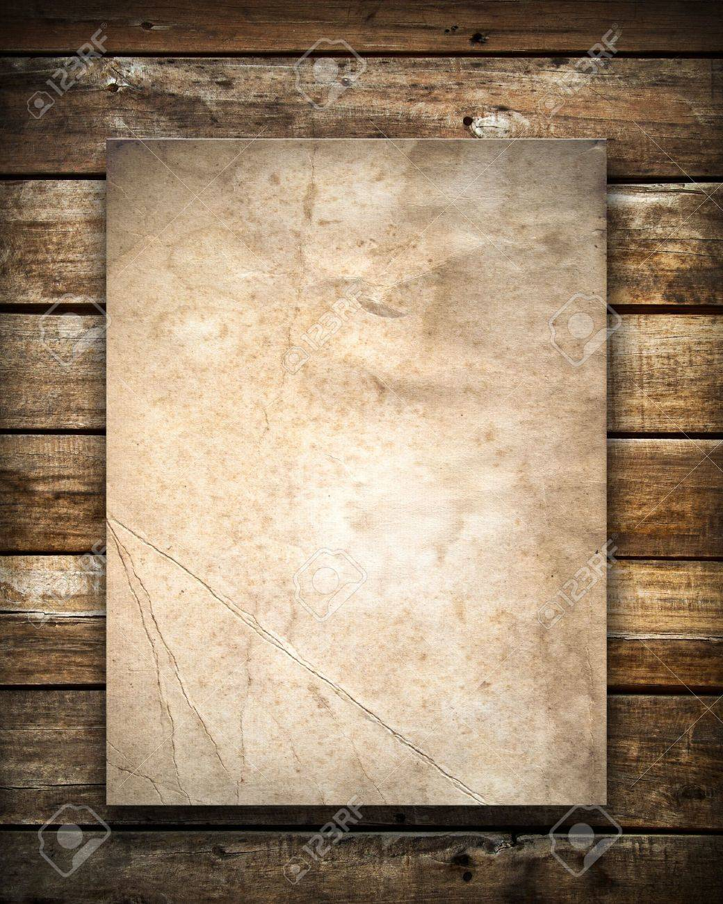 Grunge paper on old wood wall Stock Photo - 7860451
