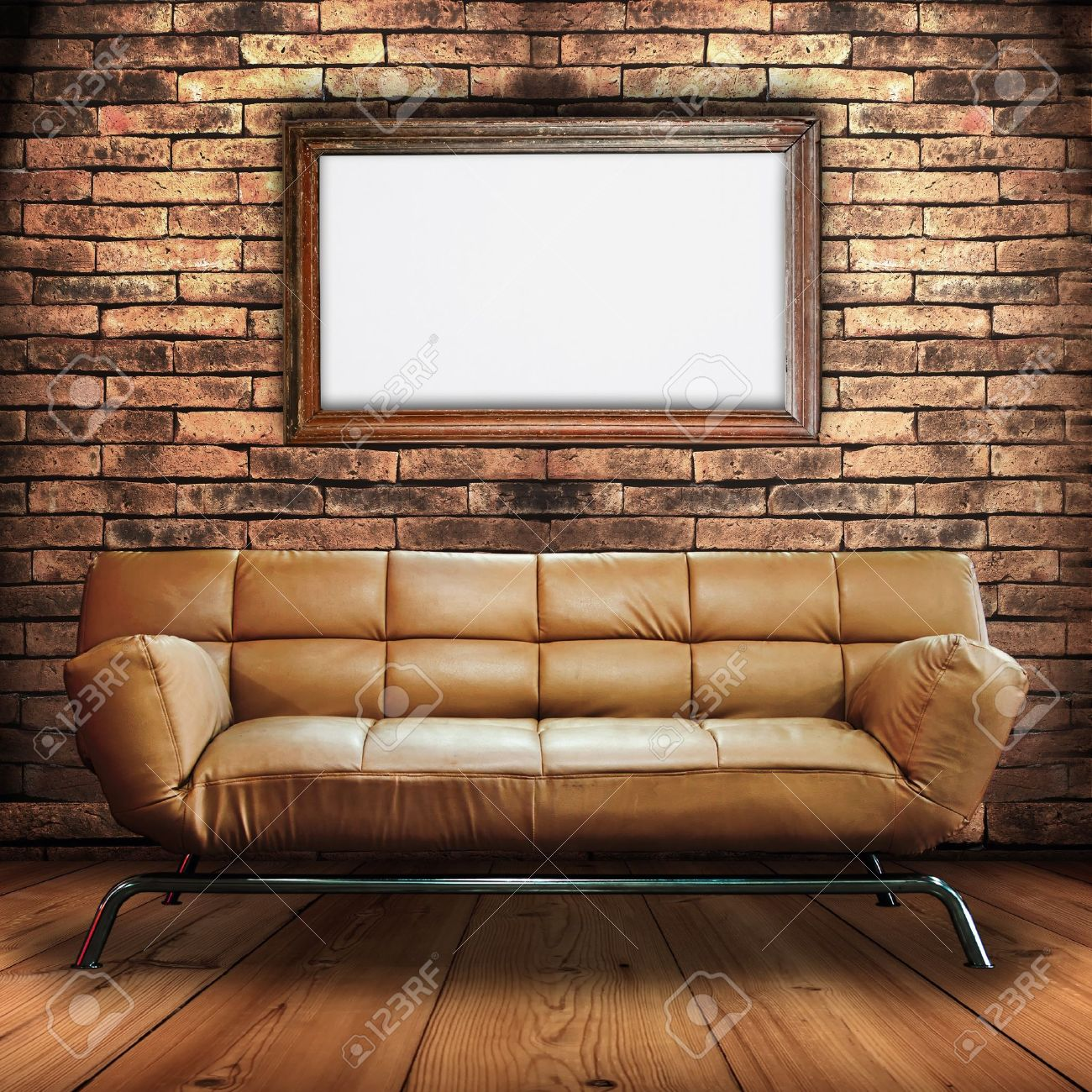 leather and wood sofa. leather sofa on wood floor and frame sign in brick wall room stock photo - p
