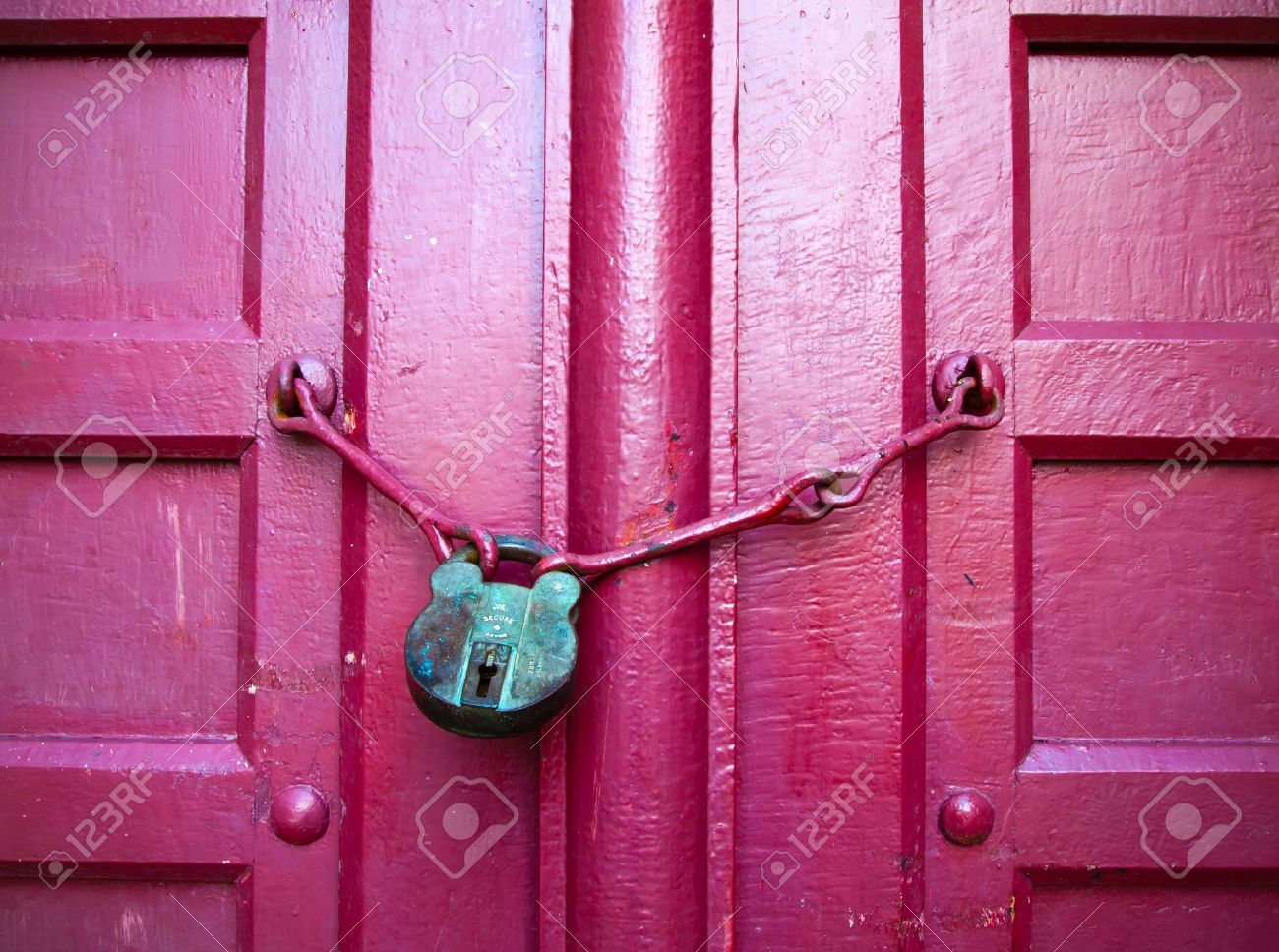 Old Lock Green Key on Close Red Wood Door Stock Photo - 8380224