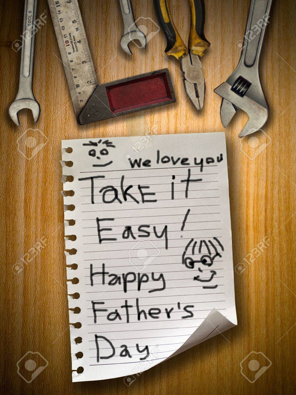 Father day note paper on wood wall and tools Stock Photo - 9639275
