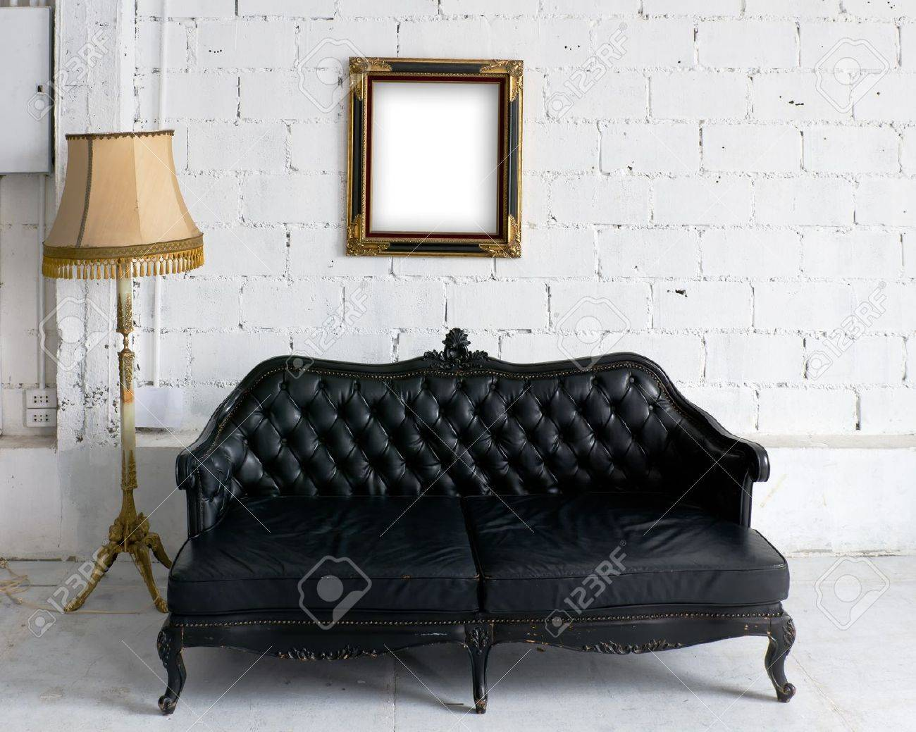 old black leather sofa with lamp and wood picture frame on white wall stock photo black leather sofa