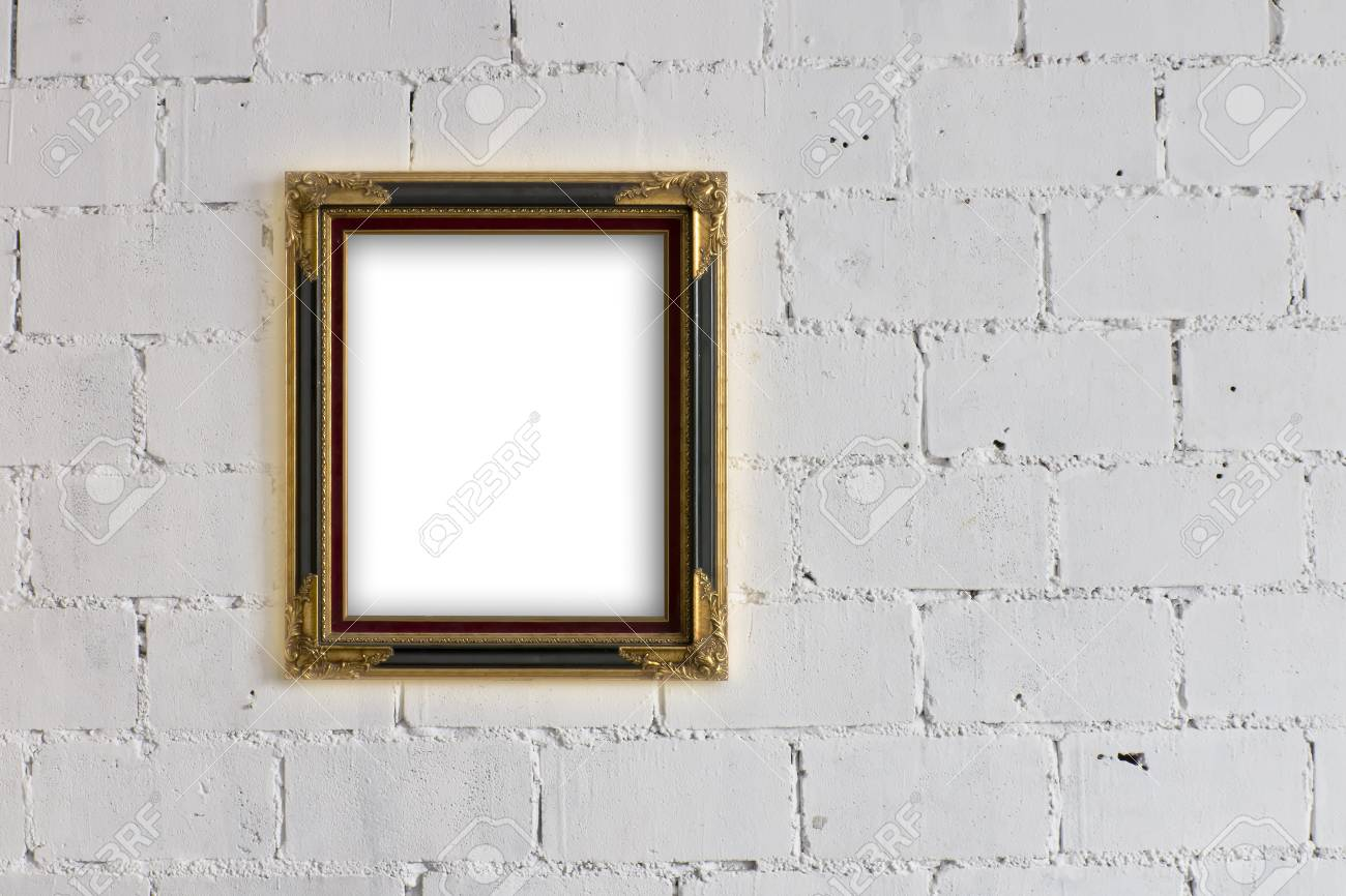 Old Wood And Gold Picture Frame Hanging On White Block Wall Stock ...