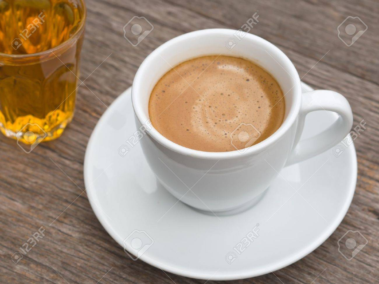 White ceramic Cup of coffee and glass of tea on Wood table Stock Photo - 11966161