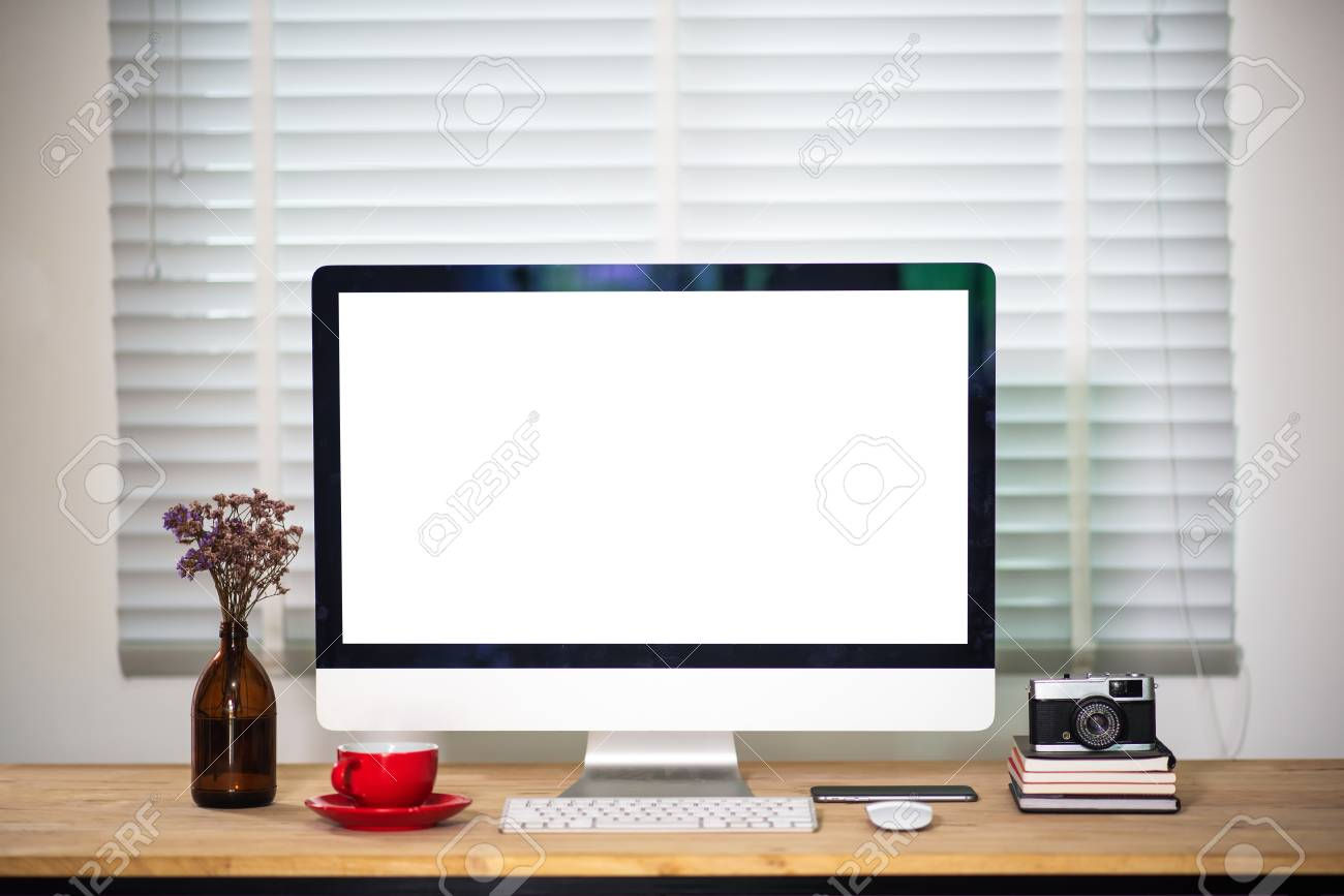 Workspace with computer Monitor, Keyboard, blank screen coffee..