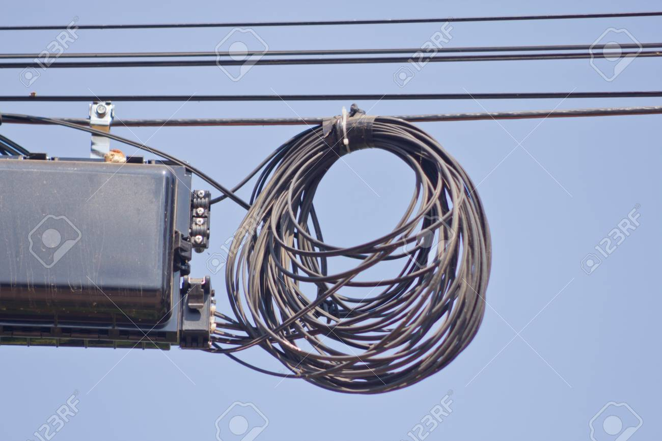 Internet Signal Box Hanging On The Cables Stock Photo Picture And Network Wiring Mess 97623280