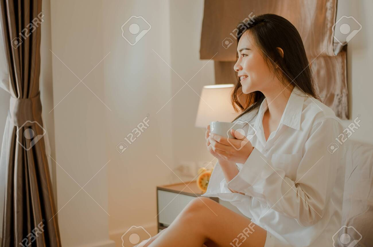 Home alone hot women Young Woman Asia Living At Home Relaxing And Drinking Cup Of Stock Photo Picture And Royalty Free Image Image 146079572