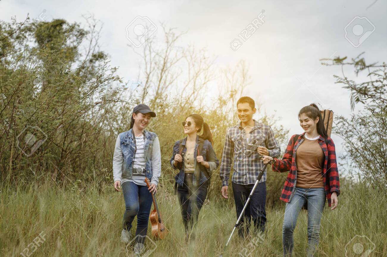 The Asian Friends Tour group enjoys hiking, trekking and watching animals, traveling and relaxing at sunset with happiness and smiles. - 145956890