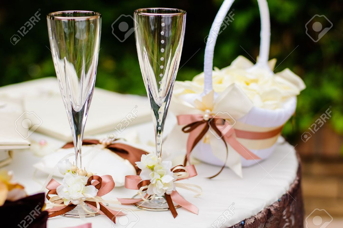 Pair of wedding wineglasses on the table - 14227417