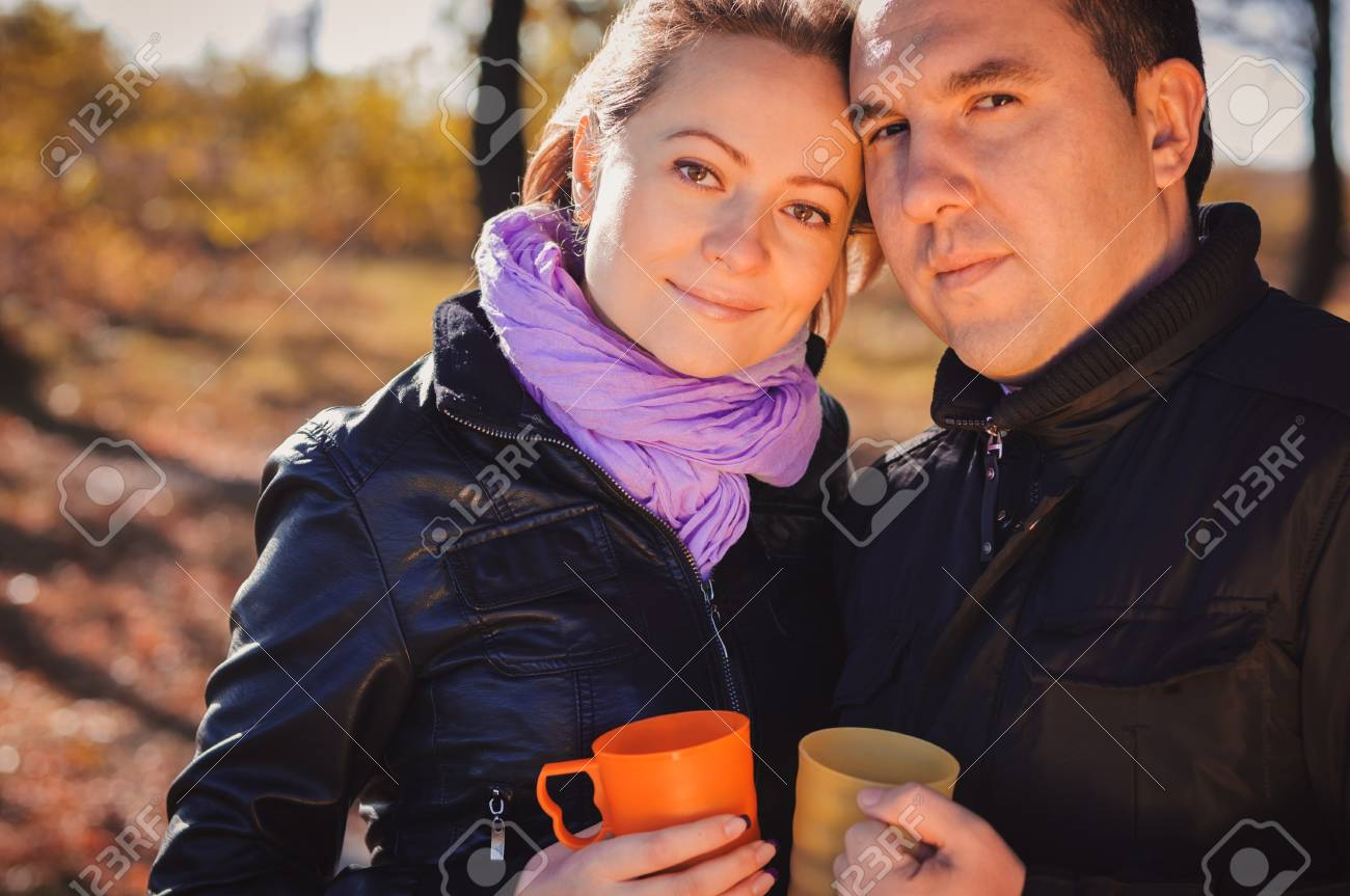 Young family drinking coffee in autumn forest Stock Photo - 17429306